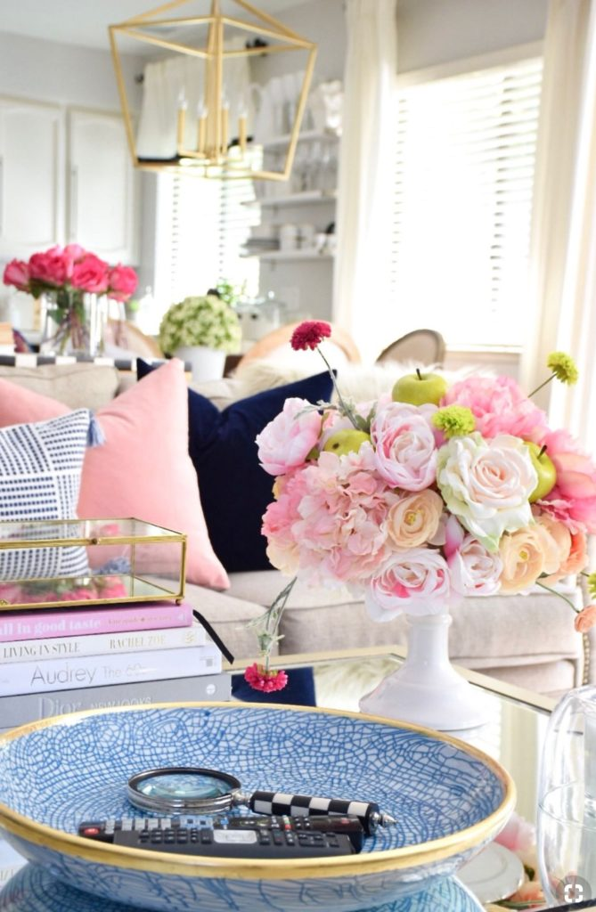 I love to use flowers, candles, coffee table books, and a catch all tray as my centerpiece