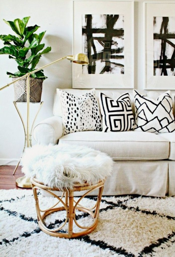I love how the geometric black and white pillows tie in with the statement wall art