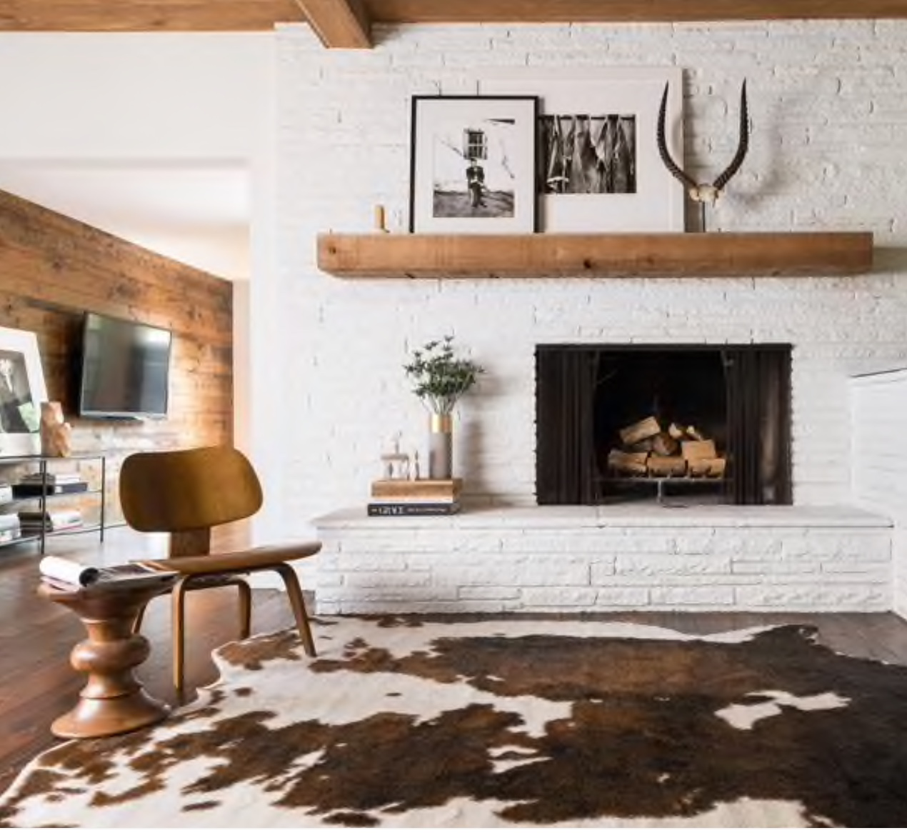 A cow hide rug is a must have masculine item